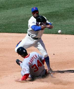 Harper got Eric Young's knee going into second.